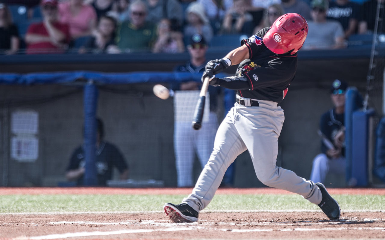 Baseball player hitting ball Vancouver Canadians baseball team